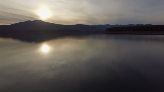 aerial shot moving across ashokan reservoir at sunset - reservoir stock videos and b-roll footage
