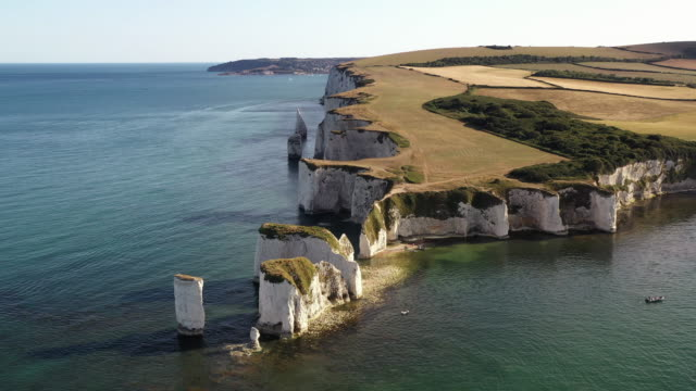 aerial shot moving down in front of old harry rocks, dorset, england, united kingdom - rock face stock videos & royalty-free footage
