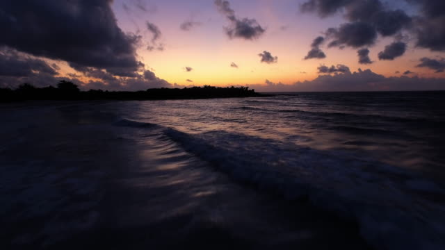 vídeos y material grabado en eventos de stock de aerial shot moving out to sea at sun rise - playa del carmen