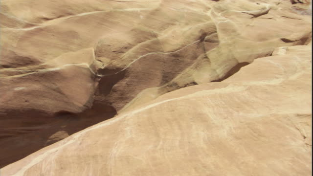 aerial shot moving over a narrow slot canyon, utah. available in hd. - narrow stock videos & royalty-free footage