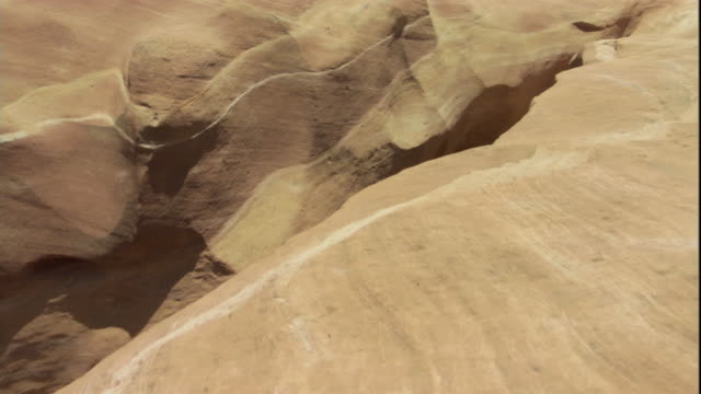 Aerial shot moving over a narrow slot canyon, Utah. Available in HD.