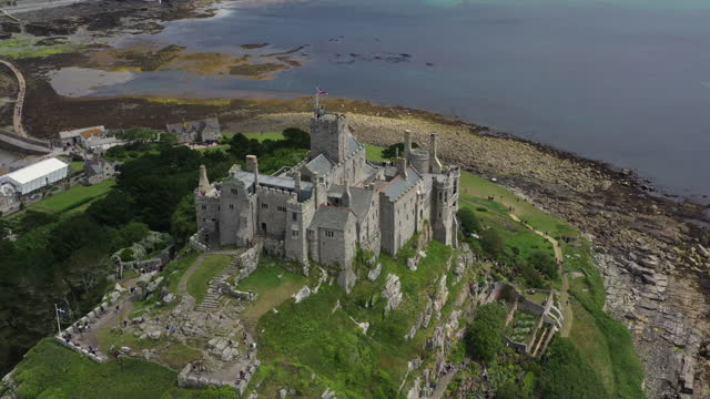 aerial shot moving slightly backwards from st michael's mount, cornwall, united kingdom - rock formation stock videos & royalty-free footage