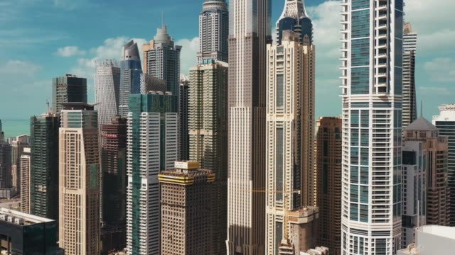 aerial shot moving up a variety of skyscrapers, dubai marina, united arab emirates - built structure stock videos & royalty-free footage