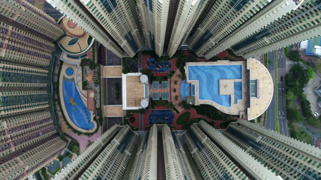 aerial shot moving up whilst looking directly down over tseung kwan o plaza, new territories, hong kong - complexity stock videos & royalty-free footage