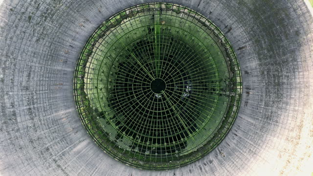 aerial shot moving up whilst looking down an abandoned smoke stack at willington power station, derbyshire, england, united kingdom - diminishing perspective stock videos & royalty-free footage