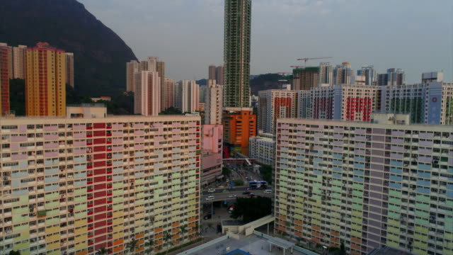 aerial shot moving upwards showing area around choi hung estate, hong kong - block shape stock videos & royalty-free footage