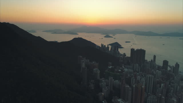 aerial shot moving upwards showing sunset from hong kong island, hong kong - hong kong island stock videos & royalty-free footage