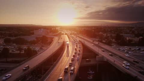 aerial shot of 10/110 interchange, los angeles at sunset - urban sprawl stock videos & royalty-free footage