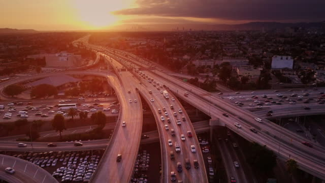 aerial shot of 10/110 interchange, los angeles at sunset - autostrada a corsie multiple video stock e b–roll