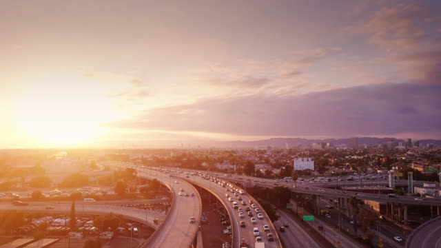 aerial shot of 10/110 interchange, los angeles at sunset - horizontal stock videos & royalty-free footage