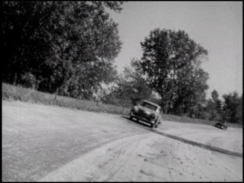 / xws aerial shot of 3mile oval on studebaker proving grounds / ws 1952 studebakers rounding turn on banked track they zoom past camera / ws... - frozen water stock videos & royalty-free footage