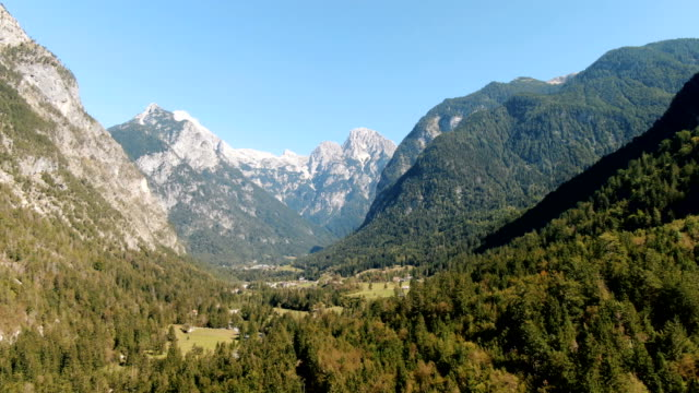 aerial shot of a beautiful green valley with surrounding mountains. triglav national park, slovenia - slovenia stock videos & royalty-free footage