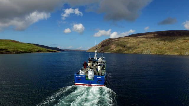 aerial shot of a boat which is used to fish mussels in shetland, scotland - fishing boat stock videos & royalty-free footage