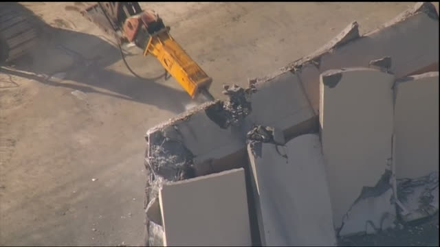 aerial shot of a border wall prototype being demolished in otay mesa california on february 27 2019 - prototype stock videos & royalty-free footage