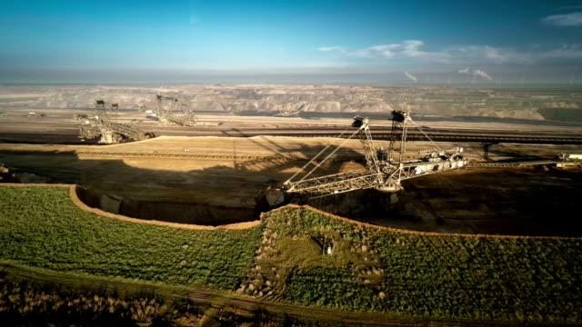 aerial shot of a brown coal surface mine with bucket wheel excavator - surface mine stock videos and b-roll footage