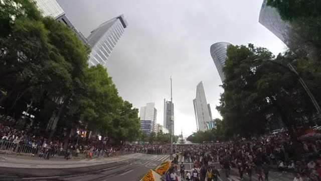 Aerial shot of a celebration day in Mexico City, modern skyline