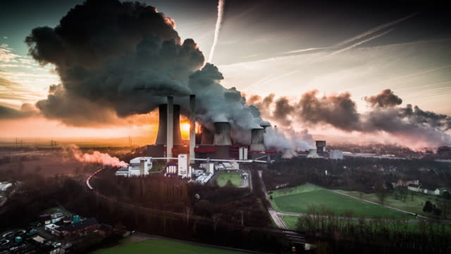 aerial shot of a coal fired power station at dusk - carbone video stock e b–roll