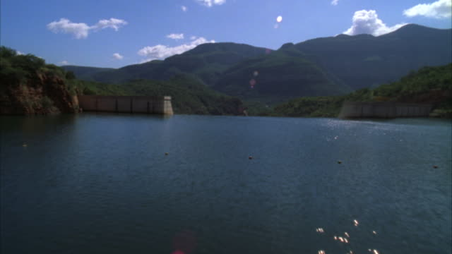 aerial shot of a dam wall down to the river below - sabie stock videos and b-roll footage