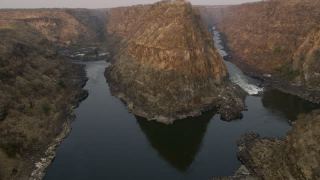 Aerial shot of a dramatic hairpin bend and land formation in the Zambezi River.