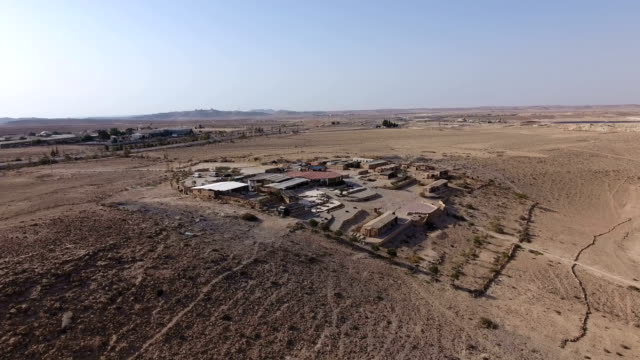 aerial shot of a farm in the negev desert - israele video stock e b–roll