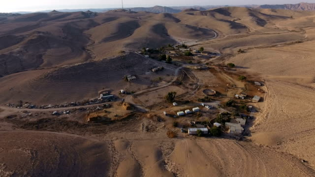 aerial shot of a farm in the negev desert - naher und mittlerer osten stock-videos und b-roll-filmmaterial