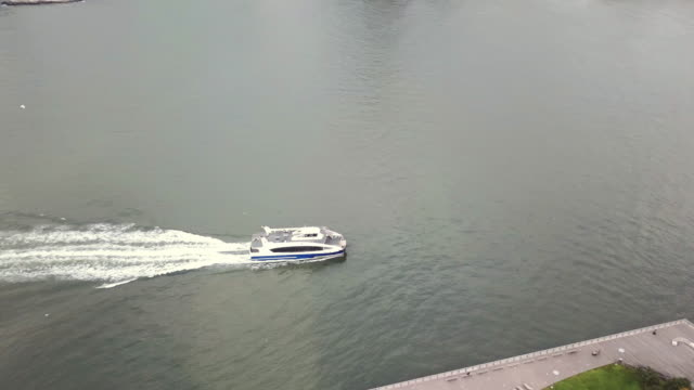 Aerial shot of a ferry landing at the waterfront of Long Island City, Queens.