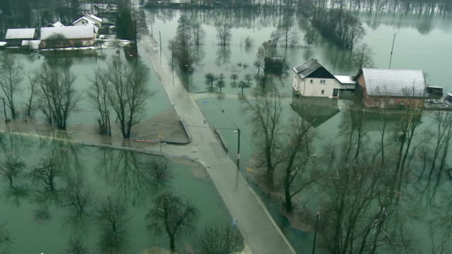 stockvideo's en b-roll-footage met aerial shot of a flooded area - vernieling