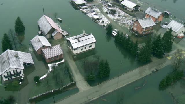 aerial shot of a flooded village - flood stock videos & royalty-free footage