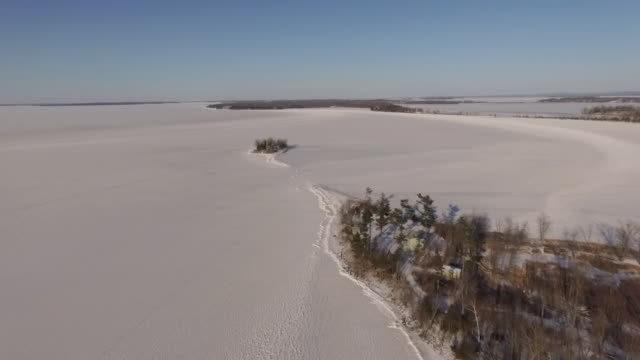 4K aerial shot of a frozen Lake Champlain in Vermont in the winter