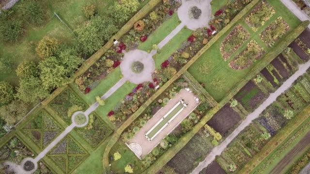aerial shot of a garden in ireland. - formal garden stock videos and b-roll footage