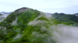 4K : Aerial Shot Of A Green Valley At Suan Phueng In Thailand