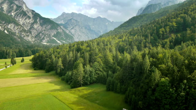 hd: aerial shot of a green valley - horizontal stock videos & royalty-free footage