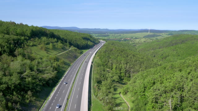 Aerial shot of a highway running through countryside