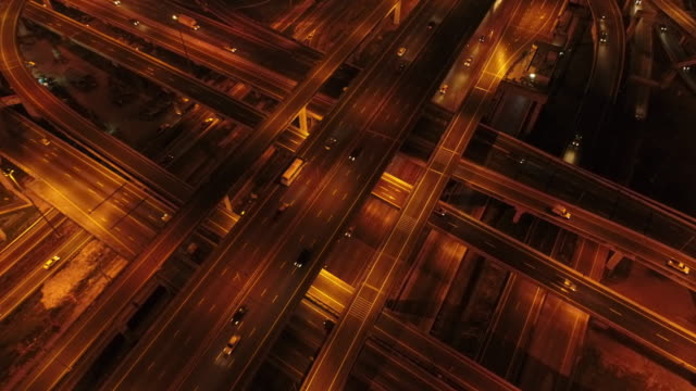 aerial shot of a highway traffic at night - road junction stock videos & royalty-free footage