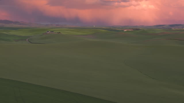 aerial shot of a landscape at sunset - palouse stock videos & royalty-free footage