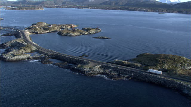 Aerial shot of a lorry travelling along the Atlantic Ocean Road in western Norway.