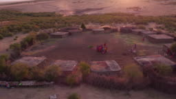 Aerial shot of a Maasai village with people