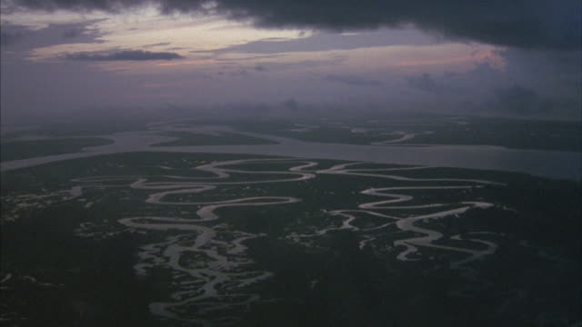 Aerial shot of a marshy river valley.