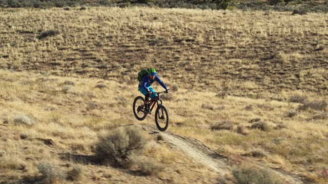 Aerial Shot of a Mountain Biker Riding a Desert Trail on 18 Road in Fruita, Colorado