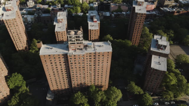 aerial shot of a new york city housing project - council flat stock videos & royalty-free footage