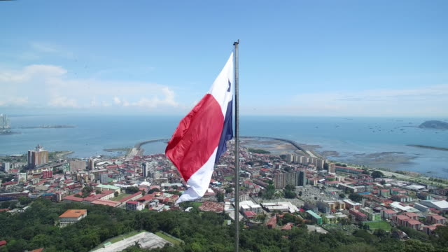 aerial shot of a panama flag on top of ancon hill - panamakanal stock-videos und b-roll-filmmaterial