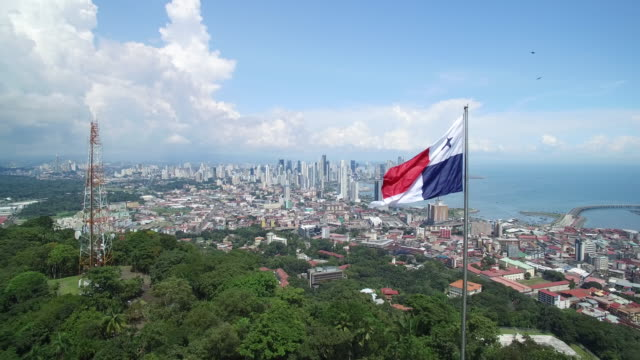 aerial shot of a panama flag on top of ancon hill - パナマ点の映像素材/bロール