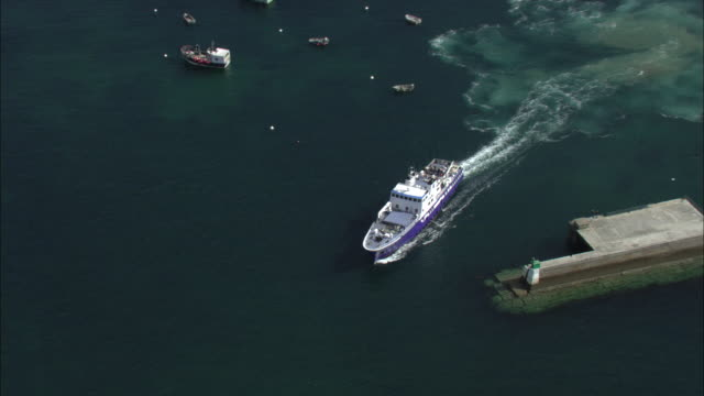 aerial shot of a passenger ferry leaving the port at le conquet.  - passenger ship stock videos & royalty-free footage