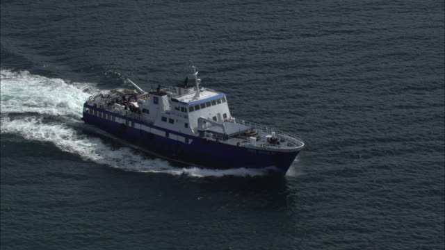 Aerial shot of a passenger ferry leaving the port at Le Conquet.