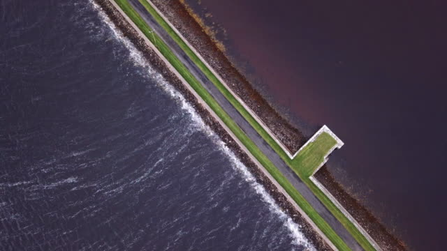 Aerial shot of a road passing over the water.