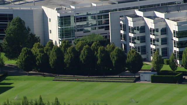aerial shot of a runner jogging on a sports field of the nike world headquarters in beaverton - headquarters stock videos & royalty-free footage