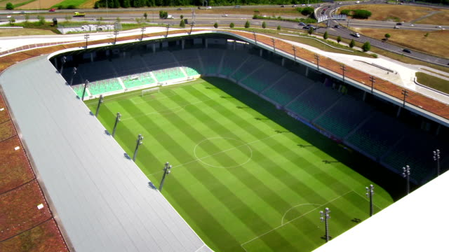 hd: aerial shot of a soccer stadium - helicopter stock videos & royalty-free footage