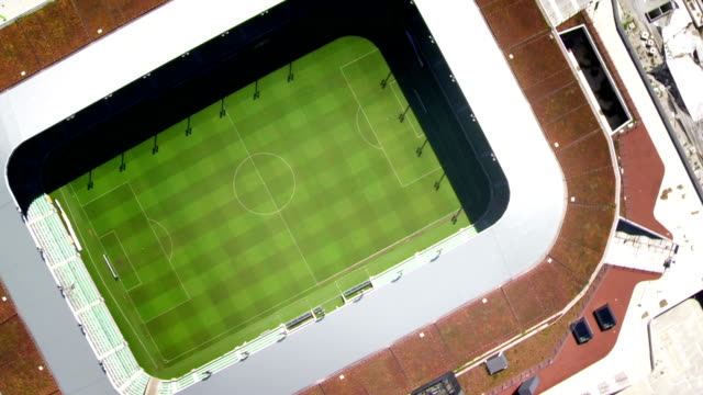hd: aerial shot of a stadium - football pitch stock videos & royalty-free footage