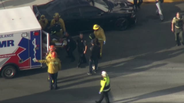 aerial shot of a student rolled out on a stretcher after a shooting at saugus high school in santa clarita california - santa clarita stock videos & royalty-free footage