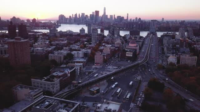 Aerial shot of a subway car passing through Brooklyn, New York City.